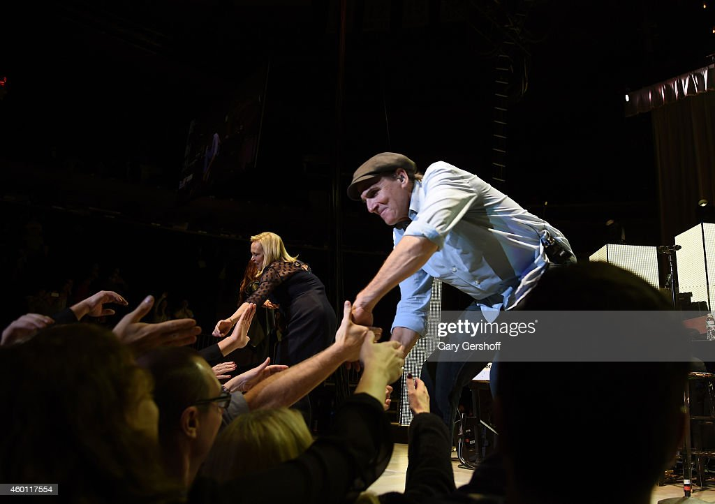 Kim Taylor (L) and James Taylor perform onstage at Madison Square Garden on December 5, 2014 in New York City.