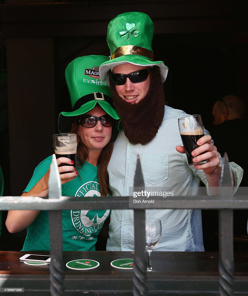 Kim Thompson and Simon Kearns celebrate St Patrick's Day inside the Three Wise Monkeys Hotel on March 16, 2014 in Sydney, Australia. St Patrick's Day is an annual religious and cultural commemoration of the widely recognised patron saint of Ireland, Saint Patrick. March 17th, is a public holiday in Northern Ireland and the Republic of Ireland but is celebrated in many countries around the world where Irish diaspora have settled.