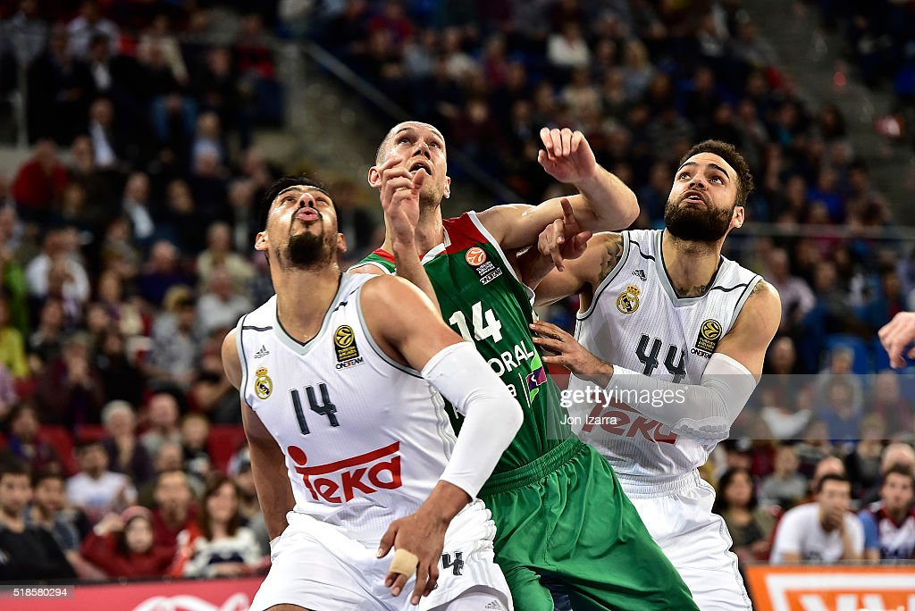 Kim Tillie #14 of Laboral Kutxa Vitoria Gasteiz competes with Gustavo Ayon #14 of Real Madrid and Jeffery Taylor #44 of Real Madrid during the...