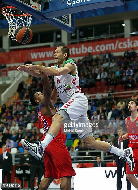Kim Tillie #14 of Laboral Kutxa Vitoria Gasteiz competes with Kyle Hines #42 of CSKA Moscow in action during the 20152016 Turkish Airlines Euroleague...