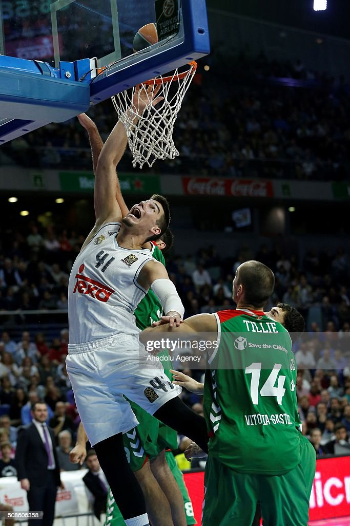 Kim Tillie of Laboral Kutxa Vitoria Gasteiz in action against Willy Hernan-Gomez (L) of Real Madrid during the Turkish Airlines Euroleague Basketball Top 16 Round 6 game between Real Madrid v Laboral Kutxa Vitoria Gasteiz at Barclaycard Center on February 5, 2016 in Madrid, Spain.