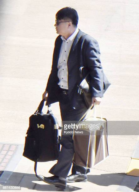 Kim Uk Il an employee of North Korea's national carrier Air Koryo arrives at an international airport in Beijing on March 31 2017 Kim linked to the...