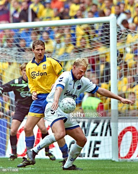 Kim Vilfort of Brondby IF and Henrik Larsen of FC Copenhagen compete for the ball during the Danish Cup Final Compaq Cup match between FC Copenhagen...