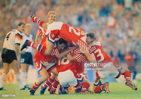 Kim Vilfort of Denmark is mobbed by teammates after scoring the second and winning goal during the UEFA European Championships 1992 Final between...