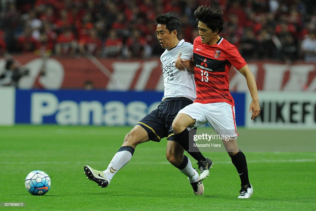 Kim Wonil #13 of Pohang Steelers (L) and Toshiyuki Takagi #13 of Urawa Red Diamonds compete for the ball during the AFC Champions League Group H match between Urawa Red Diamonds and Pohang Steelers at the Saitama Stadium on May 3, 2016 in Saitama, Japan.