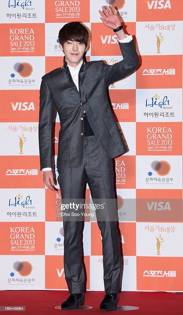 Kim Woo-Bin poses for photographs upon arrival during the 22nd High 1 Seoul Music Awards at Olympic Park on January 31, 2013 in Seoul, South Korea.