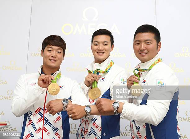 Kim Woojin Ku Bonchan and Lee Seungyun of South Korea who won gold in the Mens Team Archey attend Omega House on August 13 2016 in Rio de Janeiro...