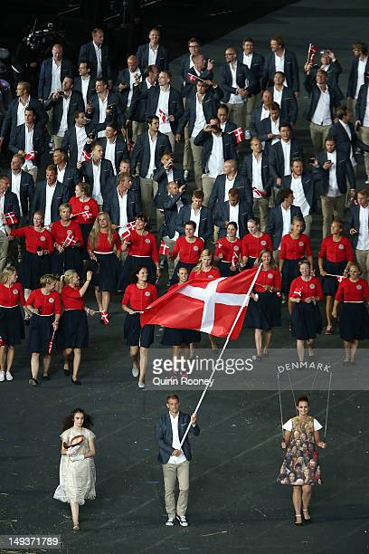 Kim Wraae of the Denmark Olympic canoeing team carries her country's flag during the Opening Ceremony of the London 2012 Olympic Games at the Olympic...