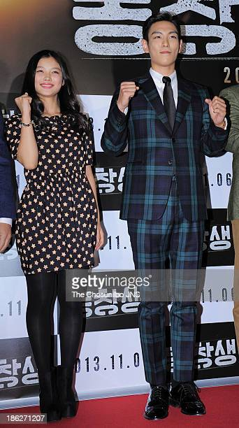 Kim YooJung and TOP attend the 'The Commitment' VIP press screening at COEX Megabox on October 29 2013 in Seoul South Korea