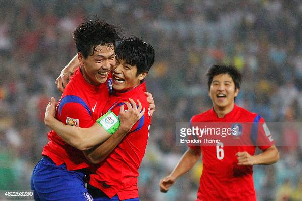 Kim Young Gwon of Korea Republic celebrates with team mate Ki Sung Yueng after scoring a goal during the Asian Cup Semi Final match between Korea...