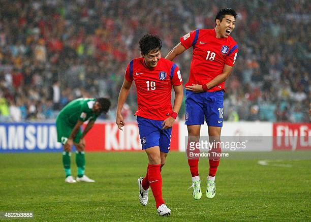 Kim Young Gwon of Korea Republic celebrates with team mate Lee Jeonghyeop after scoring a goal during the Asian Cup Semi Final match between Korea...