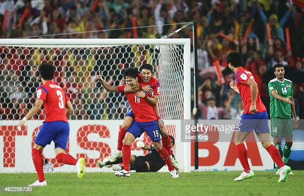 Kim Young Gwon of Korea Republic celebrates with team mates after scoring the second goal during the Asian Cup Semi Final match between Korea...