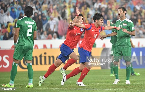 Kim Young Gwon of South Korea celebrates scoring their second goal with teammate Lee Jeonghyeop as Ahmed Ibrahim and Saad Abdullameer of Iraq look on...