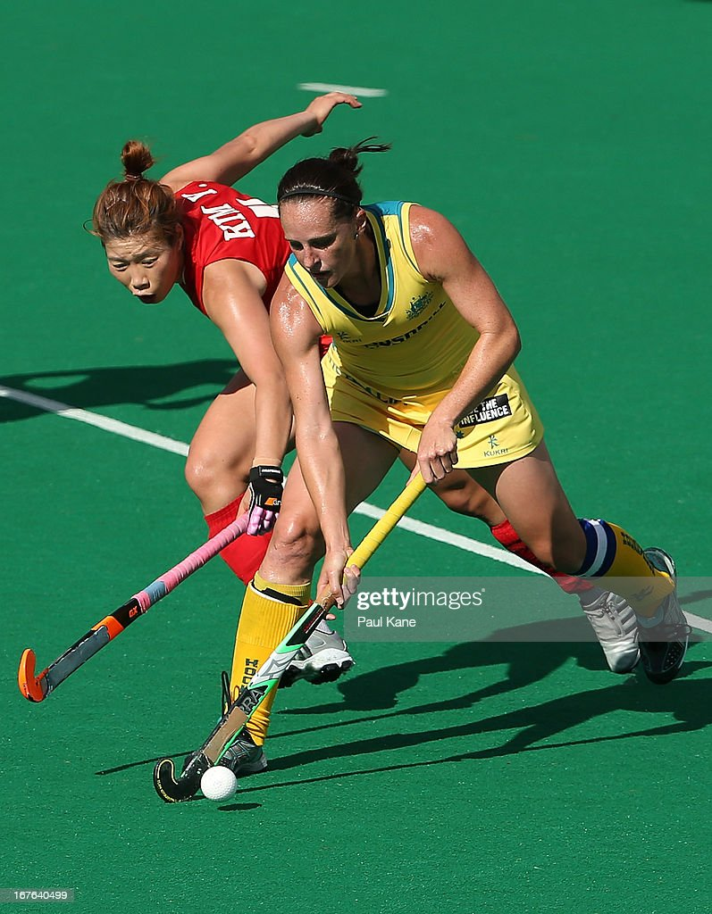 Kim Young Ran of Korea challenges Madonna Blyth of Australia during the International Test match between the Australian Hockeyroos and Korea at Perth Hockey Stadium on April 27, 2013 in Perth, Australia.