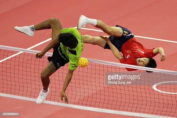 Kim YoungMan of South Korea and Aung Zaw Zaw of Myanmar challenge for the ball in the Sepaktakraw Men's Double Final during the 2014 Asian Games at...