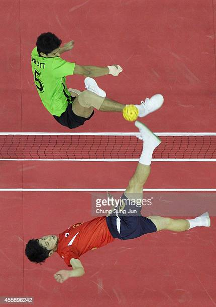Kim YoungMan of South Korea and Latt Zaw of Myanmar challenge for the ball in the Sepaktakraw Men's Double Final during the 2014 Asian Games at...