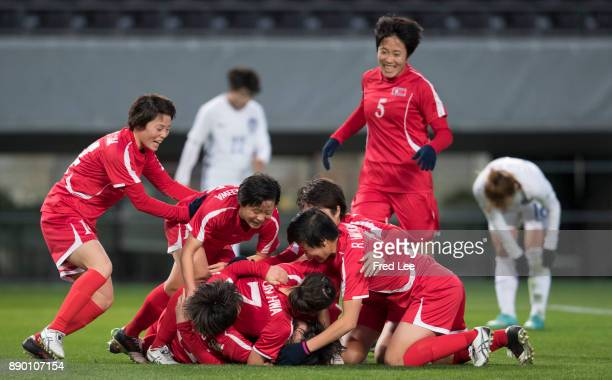 Kim Yun Mi of North Korea celebrates with team mates after scoring her team's first goal during the EAFF E1 Women's Football Championship between...