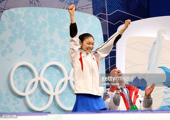 Kim YuNa of South Korea celebrates her score in the kiss and cry area with coach Brian Orser in the Ladies Free Skating on day 14 of the 2010...