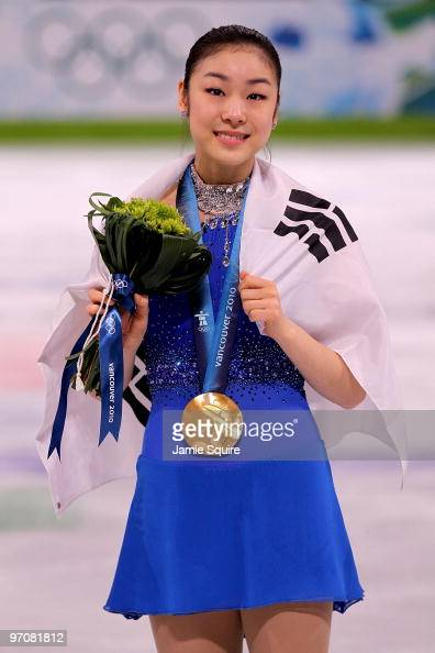 Kim YuNa of South Korea celebrates winning the gold medal in the Ladies Free Skating during the medal ceremony on day 14 of the 2010 Vancouver Winter...