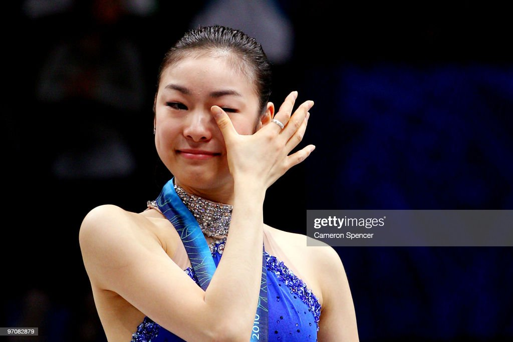 <a gi-track='captionPersonalityLinkClicked' href=/galleries/search?phrase=Kim+Yu-Na&family=editorial&specificpeople=4198415 ng-click='$event.stopPropagation()'>Kim Yu-Na</a> of South Korea celebrates winning the gold medal in the Ladies Free Skating during the medal ceremony on day 14 of the 2010 Vancouver Winter Olympics at Pacific Coliseum on February 25, 2010 in Vancouver, Canada.