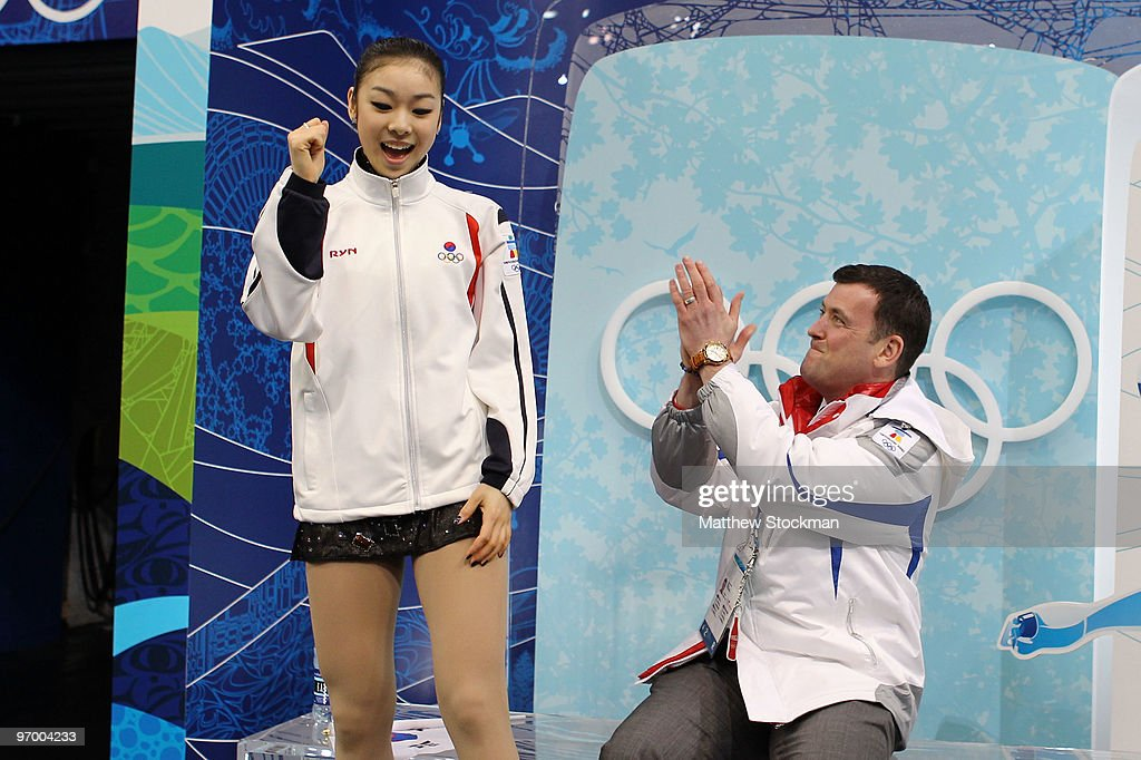 <a gi-track='captionPersonalityLinkClicked' href=/galleries/search?phrase=Kim+Yu-Na&family=editorial&specificpeople=4198415 ng-click='$event.stopPropagation()'>Kim Yu-Na</a> of South Korea sits in the kiss and cry area in the Ladies Short Program Figure Skating on day 12 of the 2010 Vancouver Winter Olympics at Pacific Coliseum on February 23, 2010 in Vancouver, Canada.