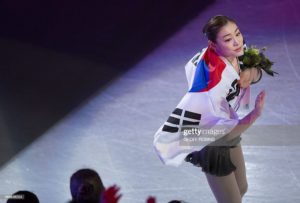 Kim Yu-na of South Korea waves after her victory on free program in the women's competition at the 2013 World Figure Skating Championships in London, Ontario, March 16, 2013. AFP PHOTO/Geoff Robins