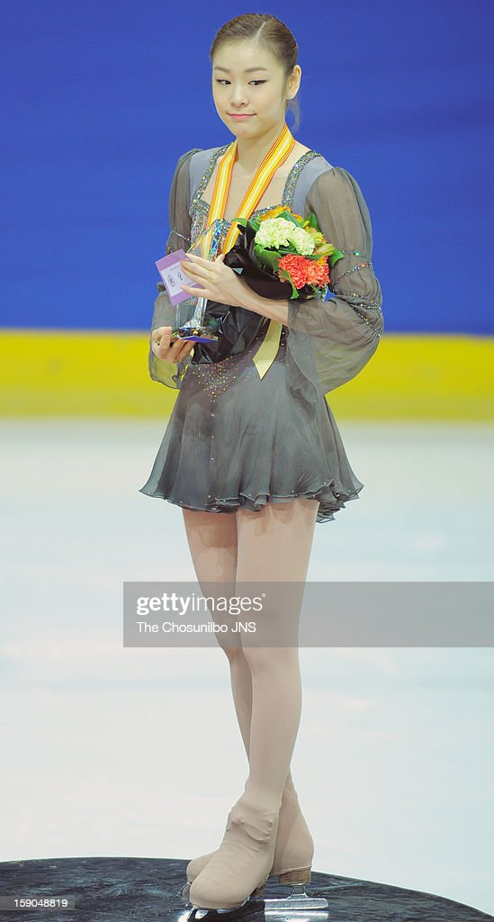 Kim Yu-Na poses for photographs at the medal ceremony after the competition during day three of Korea Figure Skating Championshpis 2013 at Mokdong Ice Rink on January 6, 2013 in Seoul, South Korea.