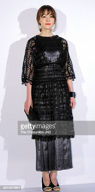 Kim YunA poses for photographs during the Culture Chanel 'The Sense of Places' opening event at DDP on August 29 2014 in Seoul South Korea