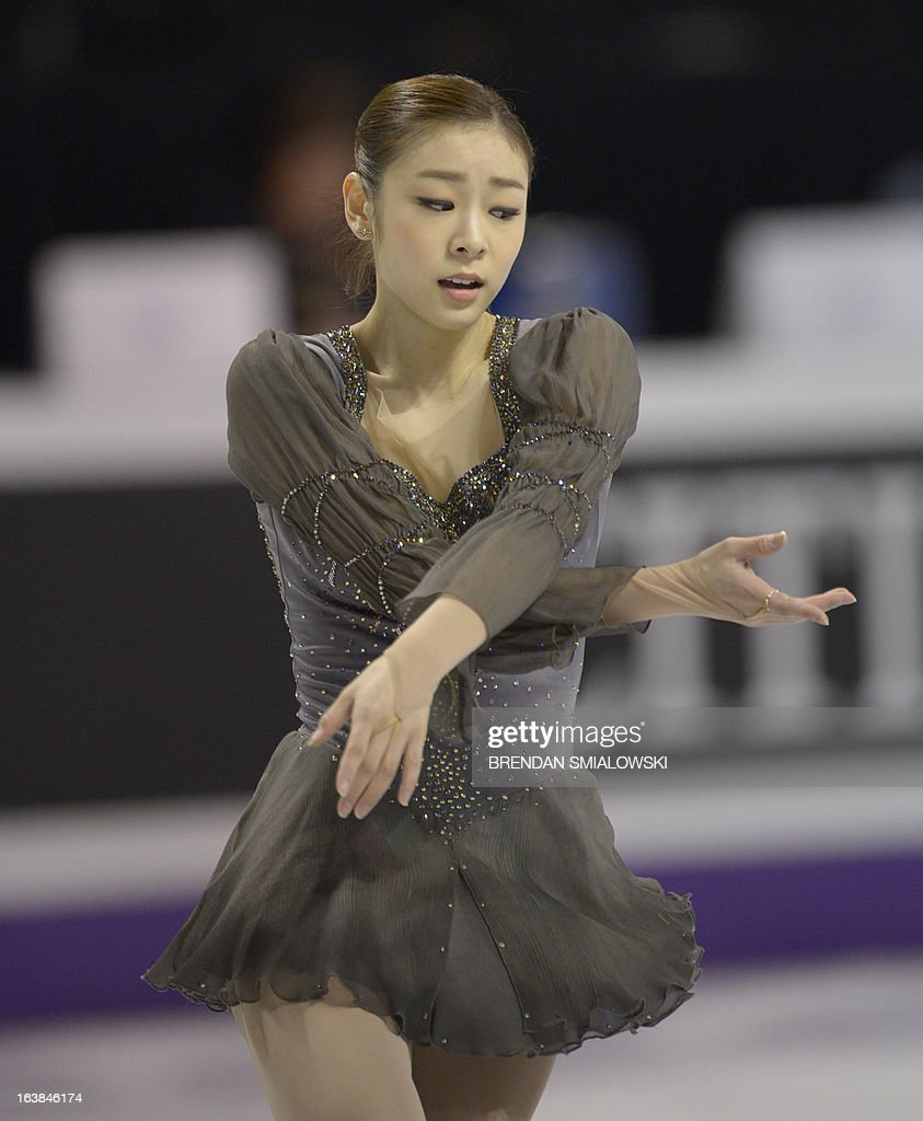Kim Yu-Na, representing South Korea, performs in the Ladies Free Skating event at the 2013 World Figure Skating Championships March 16, 2013 in London, Ontario, Canada. Reigning Olympic champion Kim Yu-Na of South Korea won the women's title at the World Figure Skating Championships, taking a runaway triumph in the free skate final. AFP PHOTO / Brendan SMIALOWSKI