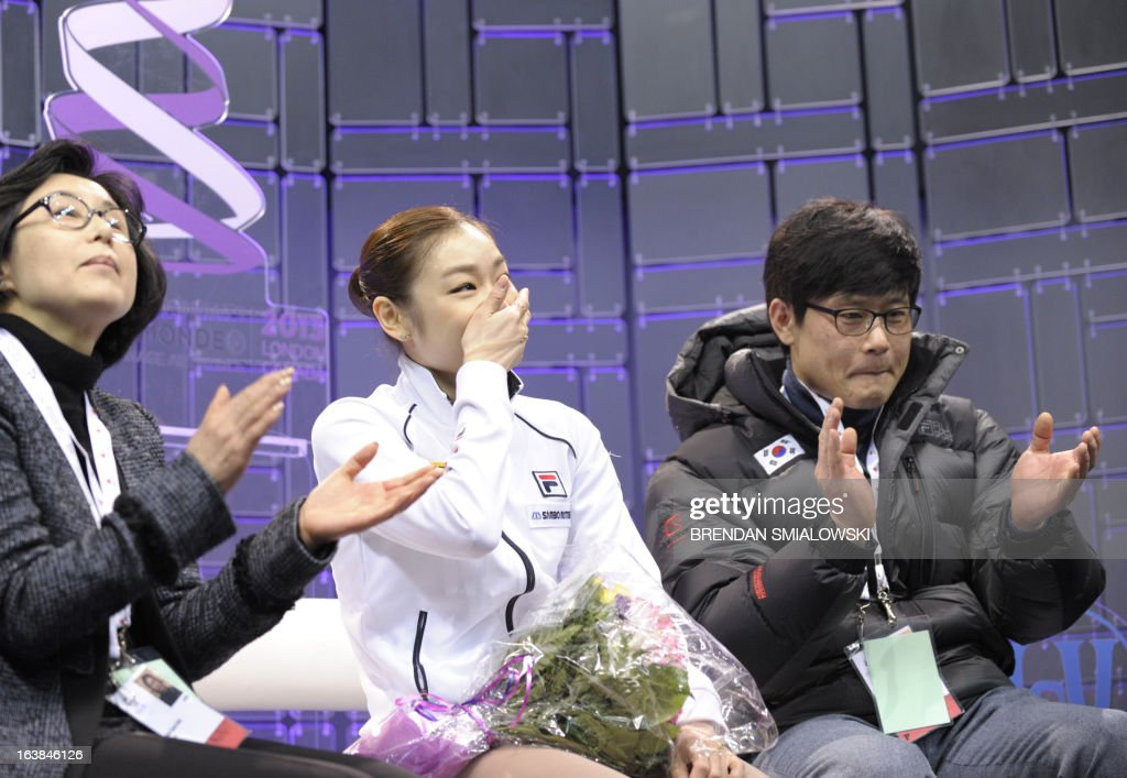 Kim Yu-Na, representing South Korea, reacts to her scores in the Ladies Free Skating event at the 2013 World Figure Skating Championships March 16, 2013 in London, Ontario, Canada. Reigning Olympic champion Kim Yu-Na of South Korea won the women's title at the World Figure Skating Championships, taking a runaway triumph in the free skate final. AFP PHOTO / Brendan SMIALOWSKI