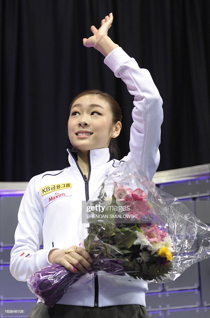 Kim Yu-Na, representing South Korea, waves following her performance in the Ladies Free Skating event at the 2013 World Figure Skating Championships March 16, 2013 in London, Ontario, Canada. Reigning Olympic champion Kim Yu-Na of South Korea won the women's title at the World Figure Skating Championships, taking a runaway triumph in the free skate final. AFP PHOTO / Brendan SMIALOWSKI