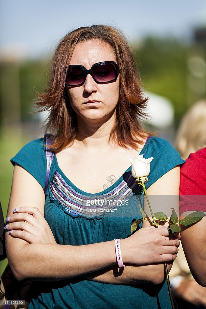 Kimber Avra attends a remembrance ceremony July 20, 2013 in Aurora, Colorado. The ceremony marks the one one-year anniversary of the Aurora Movie Theatre Shootings in which James Holmes killed 12 people and injured more than 50 during a mass shooting in 2012.