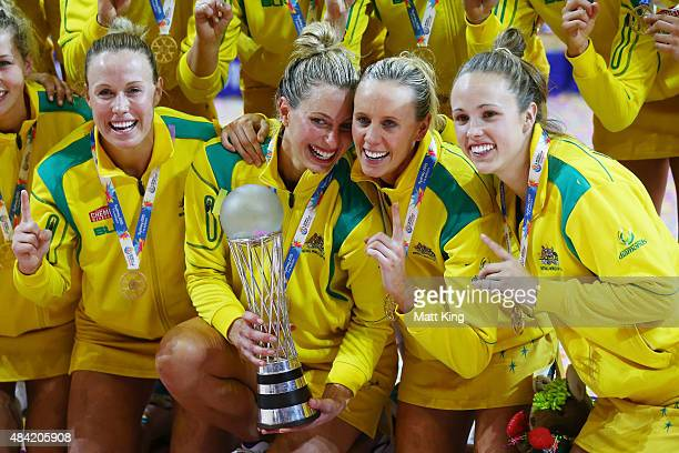 Kimberlee Green Laura Geitz Renae Hallinan and Paige Hadley of the Diamonds celebrate with the Netball World Cup trophy after victory in the 2015...