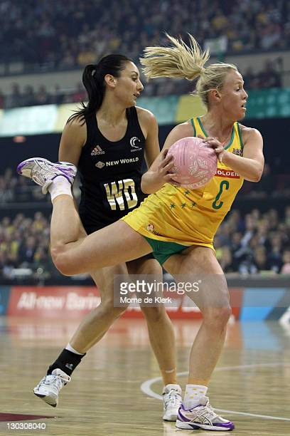 Kimberlee Green of Australia gets the ball in front of Jolene Henry of New Zealand during the second Test Match between the Australian Diamonds and...
