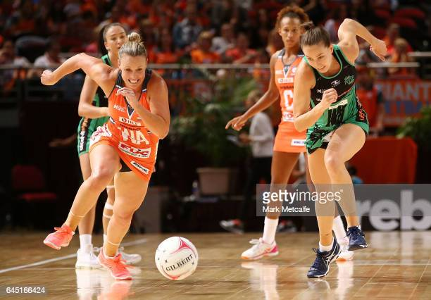 Kimberlee Green of the Giants and Shannon England of the Fever contest possession during the round two Super Netball match between the Giants and the...