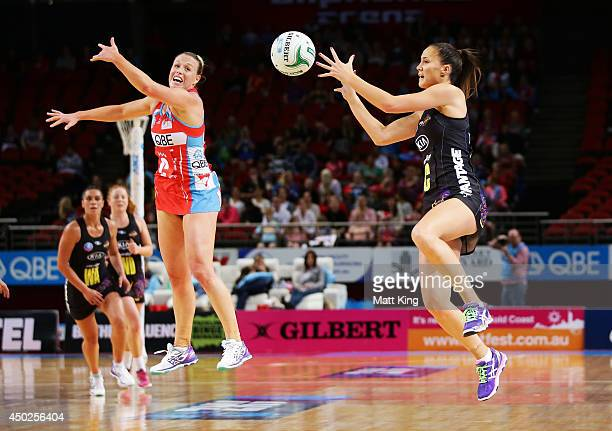 Kimberlee Green of the Swifts defends against Courtney Tairi of the Magic during the ANZ Championship Minor Semi Final match between the Sydney...