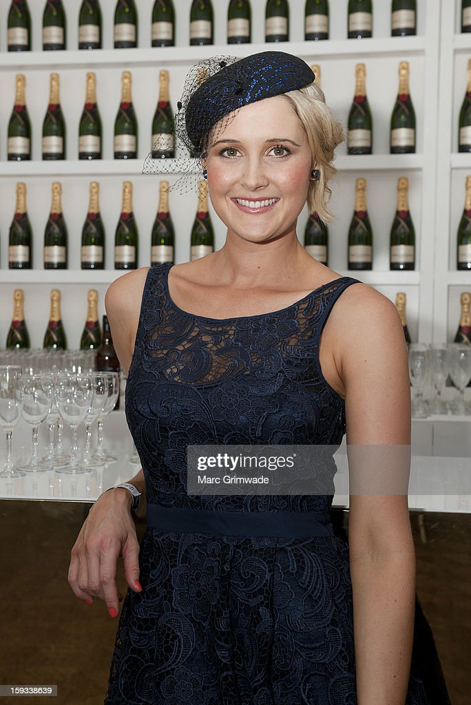 Kimberley Busteed poses in the Moet & Chandon marquee on Magic Millions Raceday at the Gold Coast Turf Club on January 12, 2013 in Gold Coast, Australia.