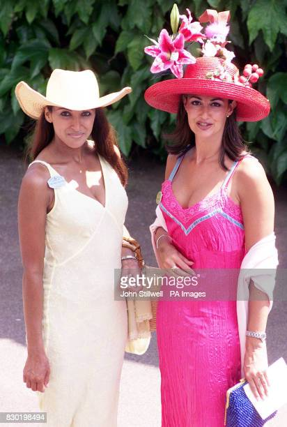 Kimberley Cowell in a red hat and Jackie St Clair in a Stetson at Ascot race course on the second day of the annual Royal race meeting