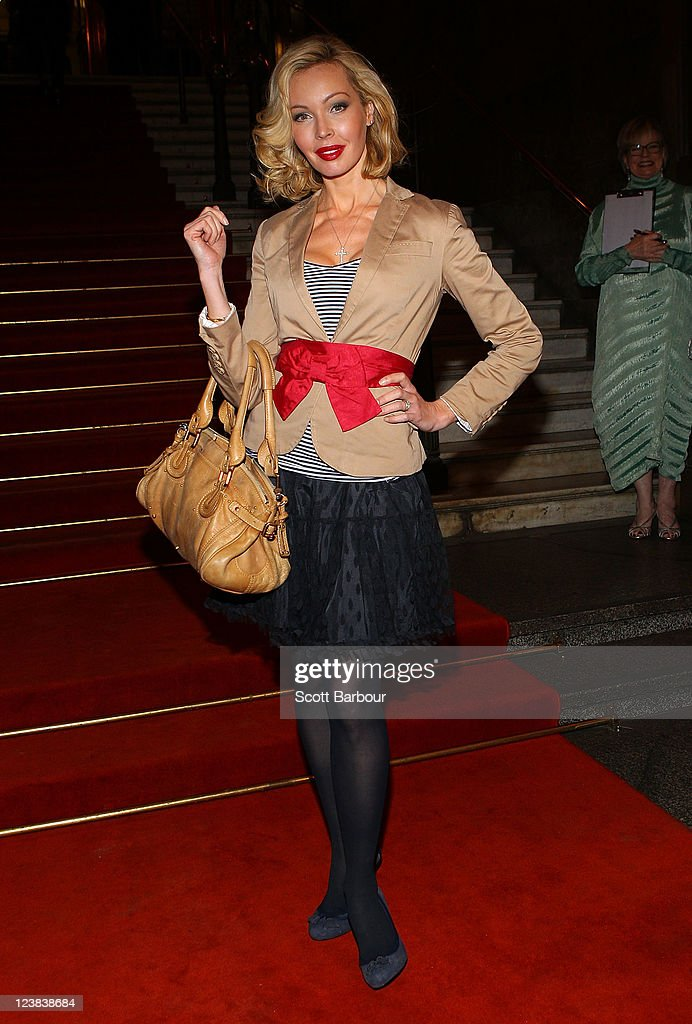 Kimberley Davies arrives at a function to unveil Dannii Minogue's favourite Melbourne Spring Fashion Week 2011 looks at Melbourne Town Hall on September 5, 2011 in Melbourne, Australia.