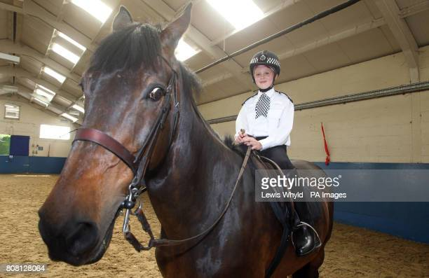 Kimberley Durrant aged 10 from Pontypool in Gwent Wales during her Starlight wish to be a mounted Police Officer at a police horse training area in...
