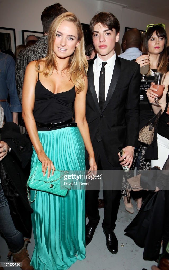 <a gi-track='captionPersonalityLinkClicked' href=/galleries/search?phrase=Kimberley+Garner&family=editorial&specificpeople=9081186 ng-click='$event.stopPropagation()'>Kimberley Garner</a> (L) and Sascha Bailey attend a private view of 'Human Relations' featuring the photographs of Fenton Bailey and Mairi-Luise Tabbakh, curated by Sascha Bailey, at Imitate Modern on May 1, 2013 in London, England.