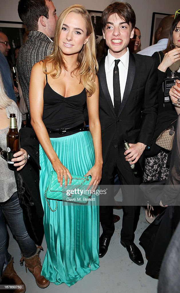 Kimberley Garner (L) and Sascha Bailey attend a private view of 'Human Relations' featuring the photographs of Fenton Bailey and Mairi-Luise Tabbakh, curated by Sascha Bailey, at Imitate Modern on May 1, 2013 in London, England.