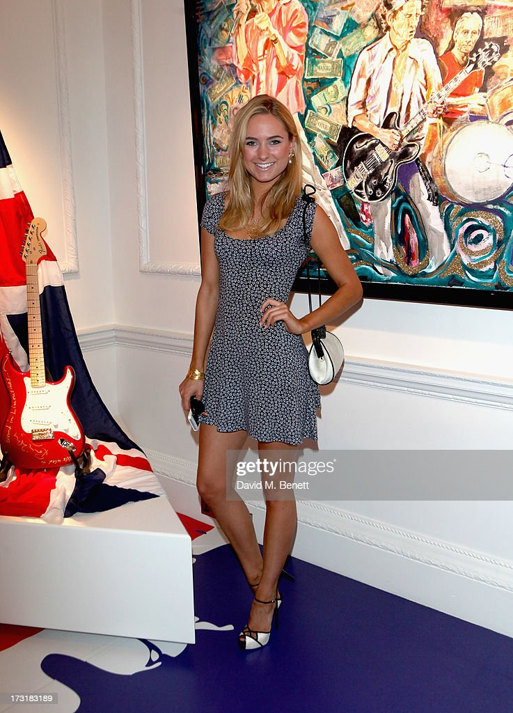 <a gi-track='captionPersonalityLinkClicked' href=/galleries/search?phrase=Kimberley+Garner&family=editorial&specificpeople=9081186 ng-click='$event.stopPropagation()'>Kimberley Garner</a> attends the Ronnie Wood Raw Instinct Exhibition Summer Party at Castle Fine Art on July 9, 2013 in London, England.