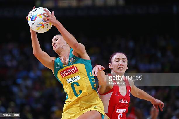 Kimberley Ravaillion of Australia catches the ball under pressure from Jade Clarke of England during the 2015 Netball World Cup Qualification round...