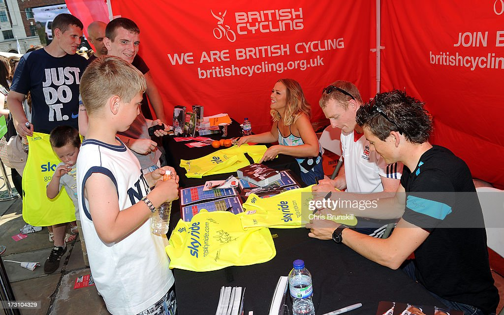 Kimberley Walsh, Matt Crampton and Ben Swift autograph bibs at Sky Ride Leeds today - a free, fun, family cycling event from British Cycling and Sky held in partnership with Leeds City Council, offering people of all ages and abilities the chance to cycle around a traffic-free city on July 7, 2013 in Leeds, England. The ride celebrated the fact that the Tour de France will start in Leeds in 2014. Find a free organised bike ride near you and see how you can get involved at www.goskyride.com - there's something for everyone.