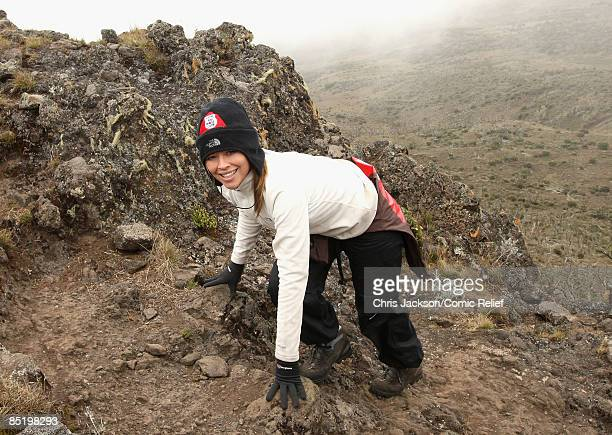 Kimberley Walsh treks up a steep section of mountain on the second day of The BT Red Nose Climb of Kilimanjaro on March 3 2009 in Arusha Tanzania...