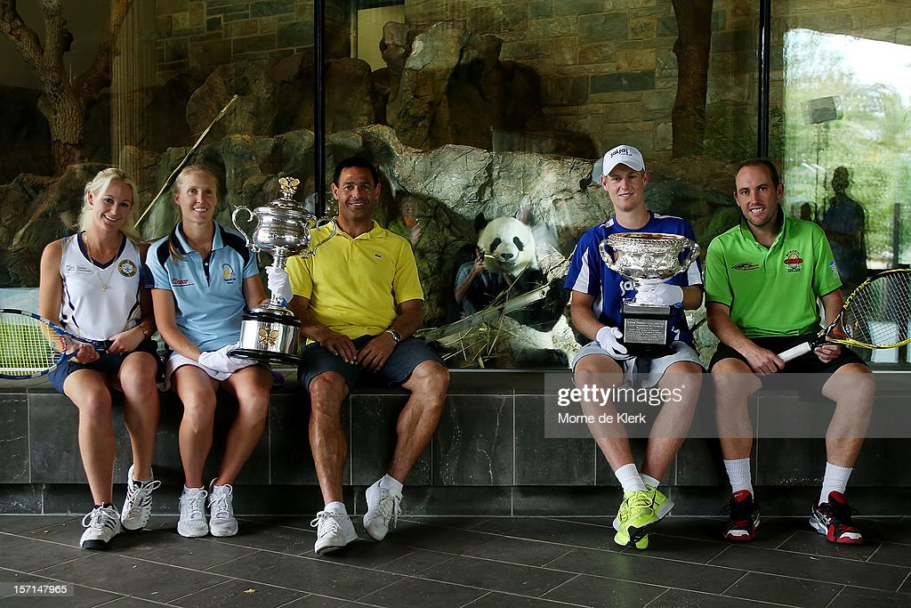 Kimberly Absalom, Olivia Lukaszewicz (holding the Daphne Akhurst Memorial cup), Roger Rasheed, <a gi-track='captionPersonalityLinkClicked' href=/galleries/search?phrase=Luke+Saville&family=editorial&specificpeople=5678639 ng-click='$event.stopPropagation()'>Luke Saville</a> (holding the Norman Brookes Challenge cup) and Colin Ebelthite in front of the panda enclosure of Funi during the Australian Open Trophy Tour at Adelaide Zoo on November 29, 2012 in Adelaide, Australia.