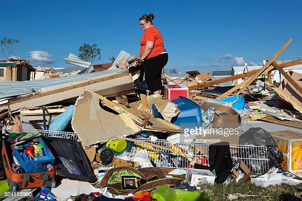 Kimberly Cicora Stands On Top Of What Is Left Her Home That Was Destroyed In