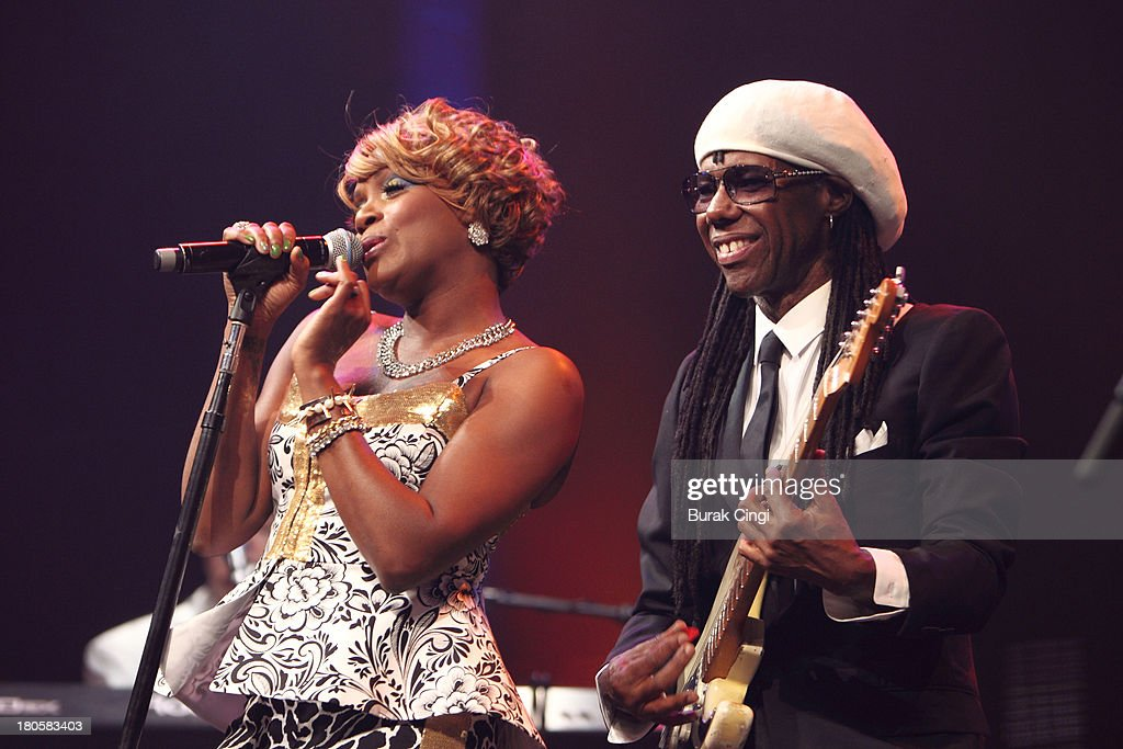 Kimberly Davis and <a gi-track='captionPersonalityLinkClicked' href=/galleries/search?phrase=Nile+Rodgers&family=editorial&specificpeople=217582 ng-click='$event.stopPropagation()'>Nile Rodgers</a> of Chic perform on stage on Day 14 of iTunes Festival 2013 at The Roundhouse on September 14, 2013 in London, England.