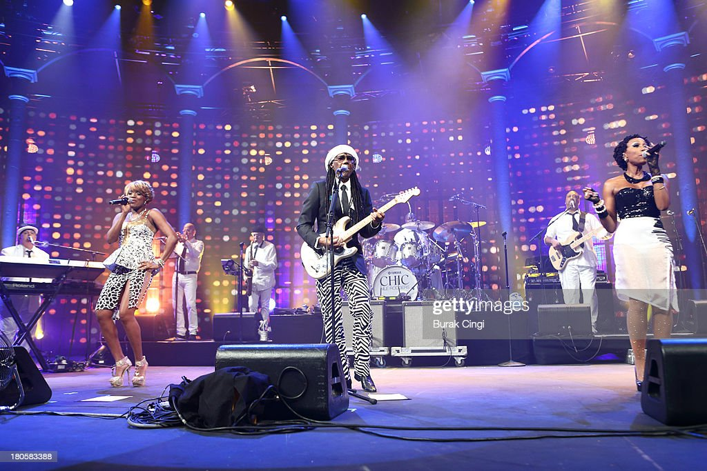 Kimberly Davis, Nile Rodgers and Folami Thompson and Chic perform on stage on Day 14 of iTunes Festival 2013 at The Roundhouse on September 14, 2013 in London, England.